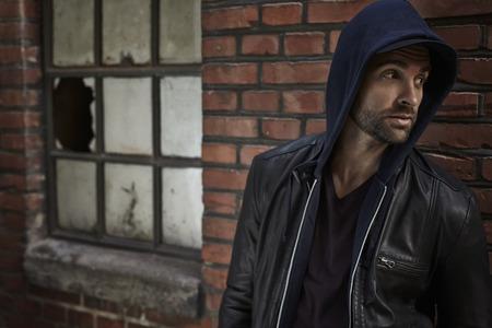 casual hooded top: Handsome man in hooded top, looking away