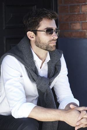 open collar: Cool guy in thought, looking away