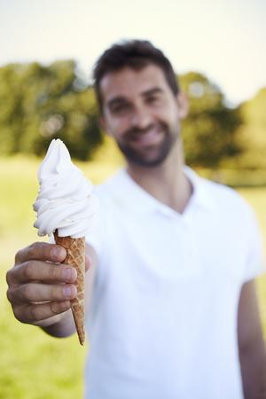 open collar: Portrait of man sharing ice cream