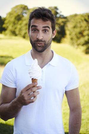 open collar: Portrait of man holding ice cream