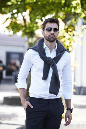 open collar: Dude in shirt and shades walking