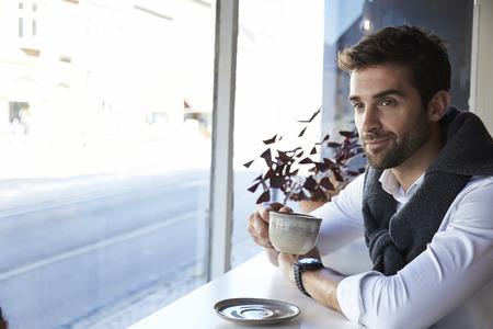 open collar: Man taking a coffee break in cafe