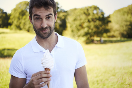 open collar: Man with ice cream looking at camera