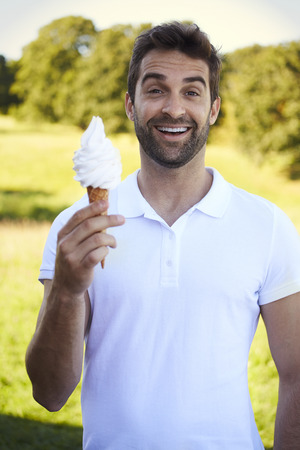 open collar: Portrait of man with ice cream, smiling