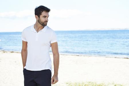 open collar: Dude on vacation standing on beach