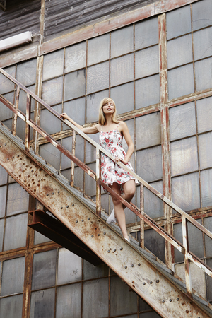steps and staircases: Posing beautiful model on steps to old building Stock Photo