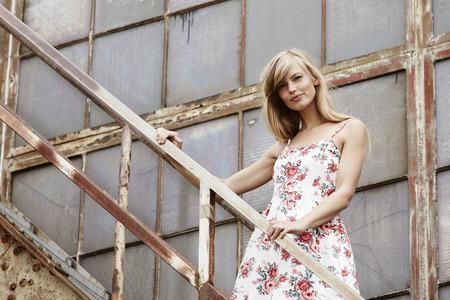 abandoned warehouse: Beautiful babe standing outside abandoned warehouse Stock Photo