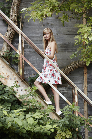 Beautiful model posing on old stairs