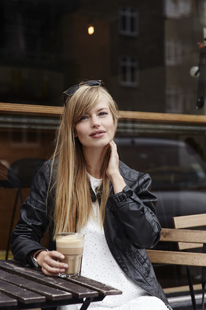 Portrait of beautiful babe in cafe