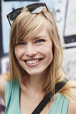 Vivacious smile on beautiful blond woman, close up Stock Photo