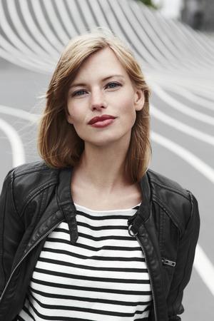 Beautiful and confident woman in striped top, portrait Standard-Bild