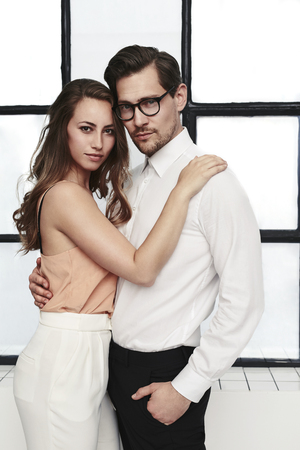 Beautiful couple in fashionable clothes, portrait