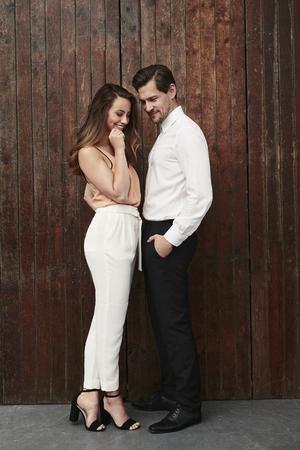 Fashionista couple in studio, smiling