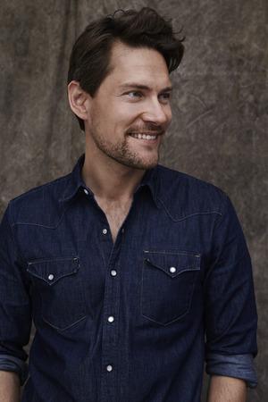 open collar: Smiling man in denim shirt, smiling