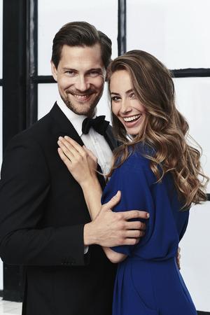 Happy and glamorously dressed couple, portrait