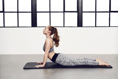 Stretching stunning woman in yoga pose Standard-Bild