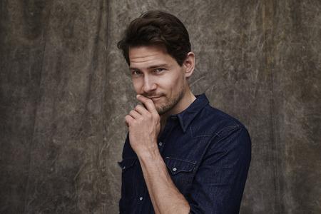 open collar: Posing man in denim shirt, portrait Stock Photo