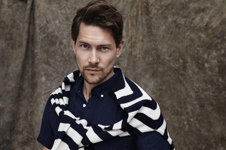 open collar: Stubble guy in striped top, portrait