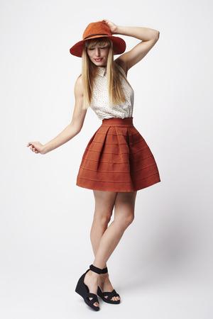 casual fashion: Posing fashion model in white studio Stock Photo