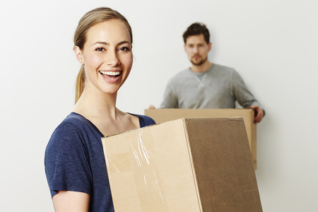 foreground focus: Beautiful woman carrying box, portrait Stock Photo