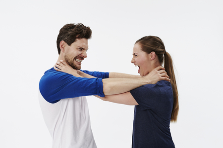 strangling: Couple strangling each other in studio