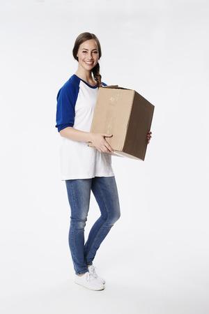 Beautiful woman with cardboard box, smiling