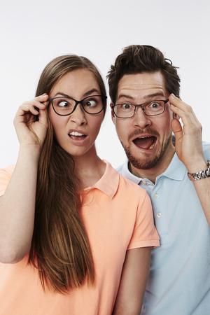 Crazy couple pulling faces, portrait