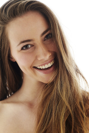 Beautiful brown eyed brunette smiling, close up Stock Photo