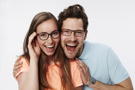 Couple in eyeglasses smiling at camera Stock Photo