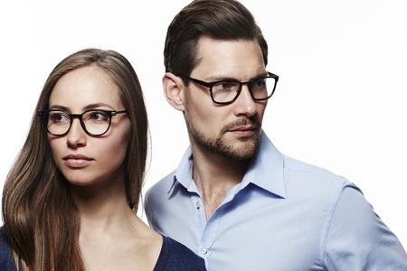 open collar: Spectacles couple looking away in studio Stock Photo