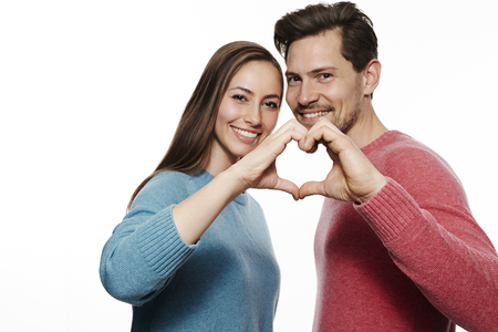 Love dovey couple making heart shape, portrait