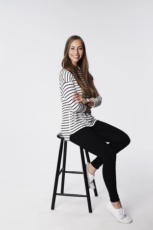 stool: Beautiful brunette on stool, portrait