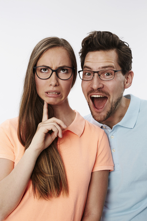 pulling faces: Silly couple pulling faces in studio