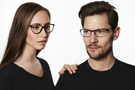 Cool couple wearing glasses in studio