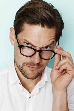 quizzical: Portrait of quizzical man in eyeglasses Stock Photo