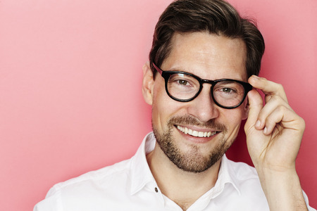open collar: Smiling guy in glasses against pink background