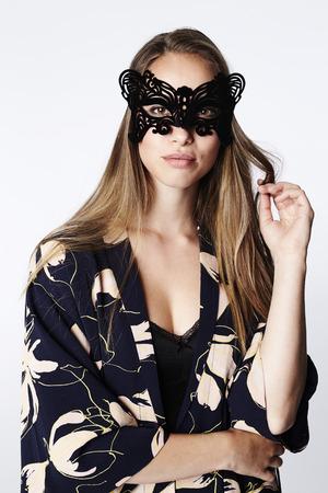 Masked beautiful woman in kimono, portrait