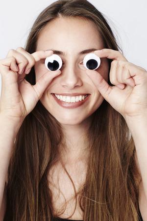 Googly eyed girl smiling at camera