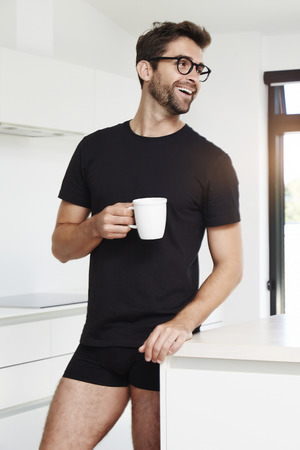 Morning in kitchen for guy with coffee Stock Photo