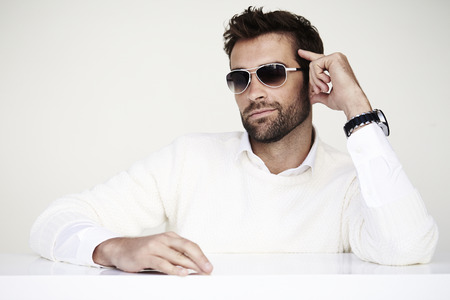 Dude in shades and white sweater, studio