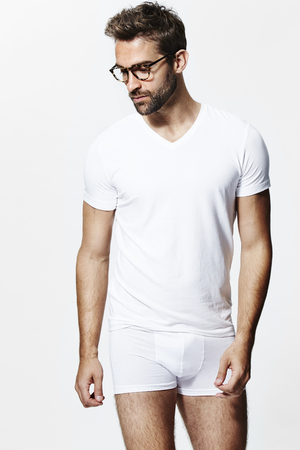 Glasses guy in underpants and white t-shirt Stock Photo