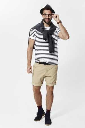 Guy in striped top and shorts, smiling