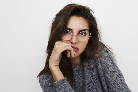 Disappointed glasses girl in grey, portrait Stock Photo