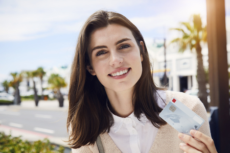 Gorgeous woman with credit card, smiling