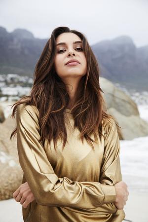 Brunette beauty in golden top, portrait