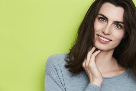 Beauty with green eyes smiling at camera