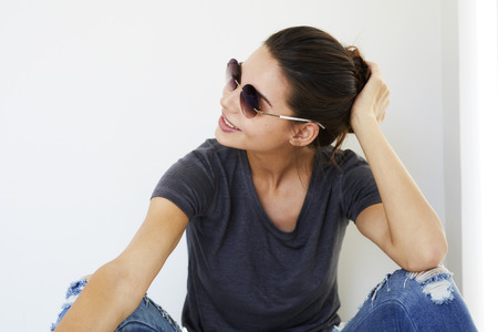 Brunette woman in shades, smiling