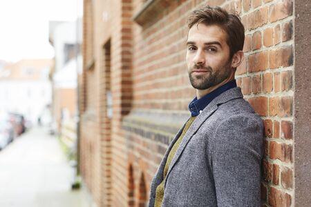 Portrait of man in jacket, smiling