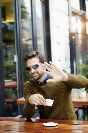 Celebrity gesturing over coffee