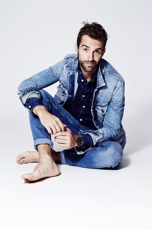 Guy wearing blue jeans and jacket, portrait Stock Photo